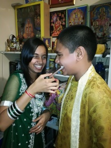 Image 8: The siblings share another moment of laughter as Trishana Ramphal sweetens her brother's mouth which is symbolic of ensuring he always has sweet and kind words to speak.
